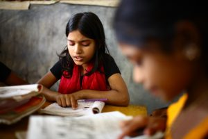 10_years_old_Dipa_and_12_years_old_Laboni_study_in_class_2_at_-Unique_Child_learning_Center-,_Mirmur-Dhaka,_Bangladesh